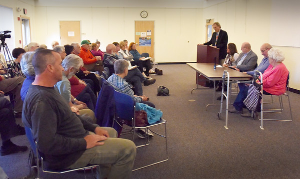 BRYAN EATON/Staff Photo. The Newbury Council on Aging and The Daily News hosted a Newbury candidate's forum Thursday night at the town's library. Editor Richard K. Lodge, at podium, emceed the event which attracted 40 people including the candidates.