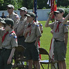 JIM VAIKNORAS/Staff photo Scouts from Troop 7 salute and cover their hearts during the playing of the National Anthem at the Memorial Day Service at Landry Stadium in Amesbury Monday.