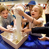 "BRYAN EATON/Staff Photo. First-graders react to ""clouds"" during a STEM  Expo at the Bresnahan School on Thursday morning. At this station, Newburyport High School students from the advanced placement chemistry class presented chemical reactions this on using hydrogen peroxide, yeast and dish soap."