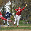 BRYAN EATON/Staff photo. Thomas Flanagan leaps to the ball but Triton's Jared Berardino makes first base.