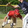 BRYAN EATON/Staff Photo. Amesbury's Tucker Molin dives back to first.