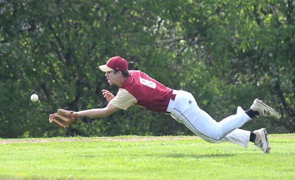 JIM VAIKNORAS/Staff photo Newburyport pitcher Walker Bartkiewics makes a play on a pop up bunt at Triton Thursday.