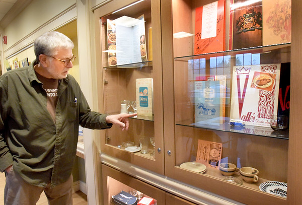 BRYAN EATON/Staff Photo. Newburyport resident Jeff Alcorn has a display at the Newburyport Senior and Community Center of some of his collection of old menus and articles from restaurants, many of which are no longer in business.