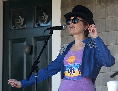 JIM VAIKNORAS/Staff photo  Festival co-founder Cynthia Keefe performs with the Bob Kramer Band at the 5th annual Plum Fest on Plum Island Saturday. The band was one of almost 100 to entertain thousands of music lovers throughout the day.