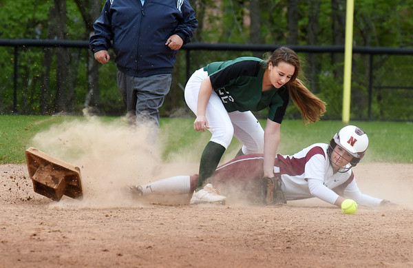 BRYAN EATON/Staff Photo. Pentucket shortstop Caitlin Kuchar couldn't get the ball as Olivia Salvatore steals second base and sends it flying.