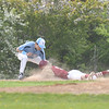 JIM VAIKNORAS/Staff photo Triton's Shane Rooney tags out Newburyport's Ryan Archie at 3rd at Triton Thursday.