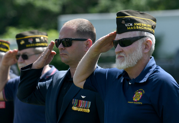 JIM VAIKNORAS/Staff photo Vertans Earl Day and Paul Jancewicz salute during the National Anthem at the Memorial Day Service at Landry Stadium in Amesbury Monday.