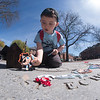 JIM VAIKNORAS/Staff photo Tarkan Kaya, 3, checks out the content of a treasure chest as he prepares for the Ships on State: A Nautical-Themed Family Scavenger Hunt in Market Square in Newburyport Saturday. The event was part of Preservation Week in the city.