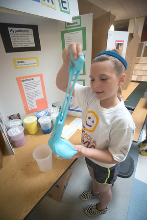 JIM VAIKNORAS/Staff photo Reagan Clyatt, 10,shows off her homemaade slime at the STEM Expo at the Molin School in Newburyport Friday.Her project she did with Kiera Giddens involved testing the slime against different environmental conditions.