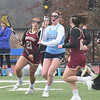 JIM VAIKNORAS/Staff photo Triton's #17 is guarded by newburyport's Samantha King (#21) and Isabel Hadden (#16) at Triton Friday.
