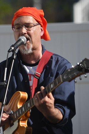 JIM VAIKNORAS/Staff photo Ed Cameron of Pathological Outliers performs at the 5th annual Plum Fest on Plum Island Saturday. The band was one of almost 100 to entertain thousands of music lovers throughout the day.