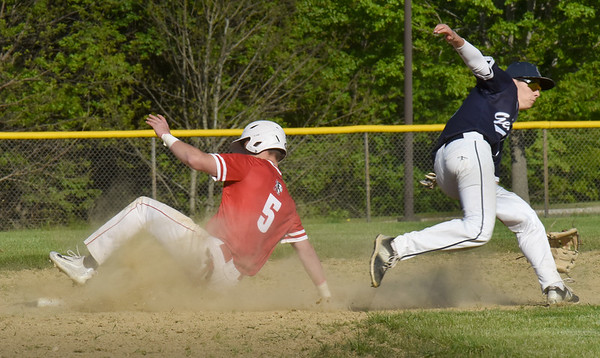 BRYAN EATON/Staff Photo. Logan Burrill slides to second on a steal.