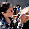 JIM VAIKNORAS/Staff photo Kalla Lively pains her friend Elizabeth Boeke face at the Riverwalk Brewing Co.Saturday during a fund raiser to build an inclusive playgound at the Bartlet Mall.
