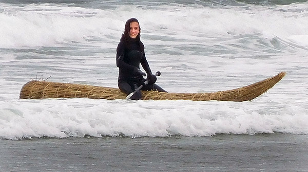 Amanda Getchell/Staff Photo. Gianna Minichiello makes it back go shore after taking her turn of paddling the reed raft.