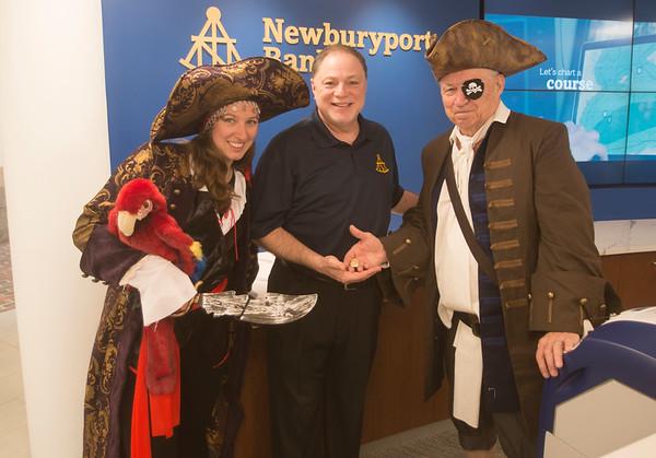 JIM VAIKNORAS/Staff photo Ester Gritsch and Lloyd Sandborn of the Maritime Museum flank Newburyport bank president Lloyd Hamm to promote the Nao Santa Maria visit to Newburyport next weekend.