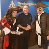 JIM VAIKNORAS/Staff photo Ester Gritsch and Lloyd Sandborn of the Maritime Museum flank Newburyport bank president Lloyd Hamm to promote the Nao Santa Maria visit to Newburyport next weekend.