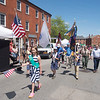 JIM VAIKNORAS/Staff photo   Scouts in the Memorial Day Parade make their way up State Street in Newburyport  Monday morning.