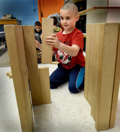 BRYAN EATON/Staff Photo. Ryder Neal, 6, builds a house out of blocks as his friends creature other structures at the Boys and Girls Club in Salisbury. They were in the Club Common Room where they have access to board games, Legos and other activities.
