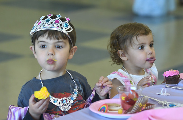 JIM VAIKNORAS/Staff photo George Alex, 3, and his sister Phoebe, 2, enjoy cup cakes at the Princess Tea Party fund raiser for the Freshman Class at Amesbury High School Saturday. The event featured Pin the Kiss on the Frog, Princess Bowling, dancing, cup cakes, Princess Limbo, and finger sandwiches.