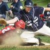 BRYAN EATON/Staff Photo. The Hamilton-Wenham first baseman looses the ball as Cam Chambers went back on an attempted steal and did make it to second on the missed throw.