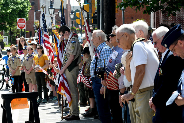 JIM VAIKNORAS/Staff photo Local veterans and scouts bow their head during the invocation at the Memorial Day Service at Newburyport City Hall Monday morning.
