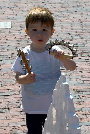 JIM VAIKNORAS/Staff photo Van Demer, 19 months, picks out some musical bells at the First Religious Society yard sale Saturday afternoon in Newburyport.
