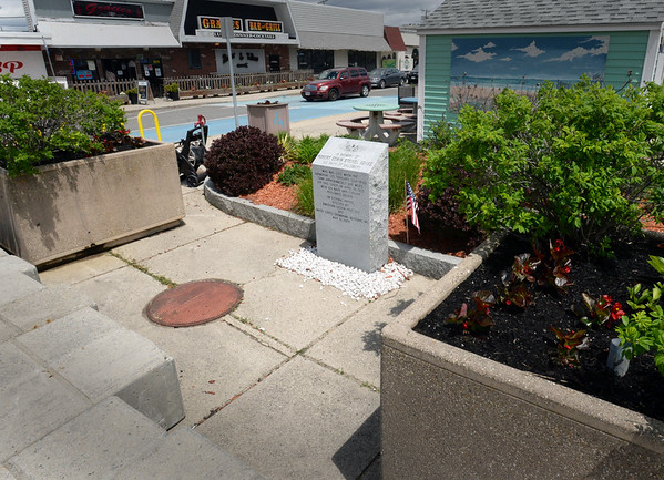 BRYAN EATON/Staff Photo. Mary Steinel-Andriotakis is upset that the monument to the men who perished on the submarine USS Thresher, including her father, Robert Steinel, which sank off Cape Cod in the 60's, is obscured by benches and planters at the entrance to Salisbury Beach Center.