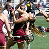 JIM VAIKNORAS/Staff photo Newburyport's Maggie Pons gets hit with a stick against Sudbury during the Harlem Lacrosse Tournament in Boston Saturday.