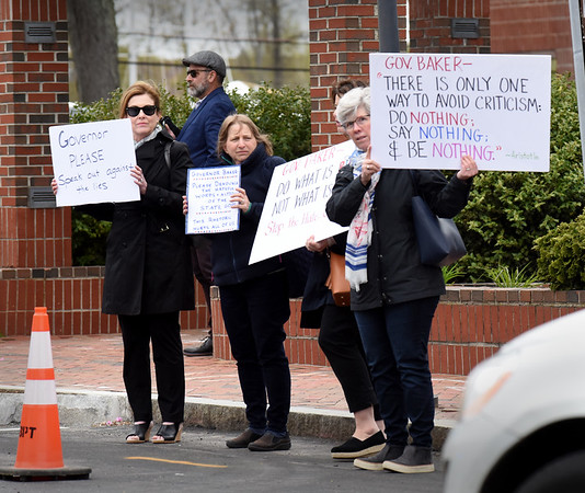 BRYAN EATON/Staff Photo. Several people showed up at the Newburyport Parking Garage ribbon-cutting protesting Gov. Charlie Baker.