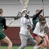 BRYAN EATON/Staff Photo. Newburyport goalie Erin Osinski in the middle of the action.