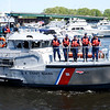 JIM VAIKNORAS/Staff photo Members of the US Coast Guard  toss a wreath into the Merrimac River in Newburyport at the Memorial Day Service  Monday morning.