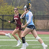 JIM VAIKNORAS/Staff photo Triton's #5 drives on Newburyport's Malaina Lucci at Triton Friday.