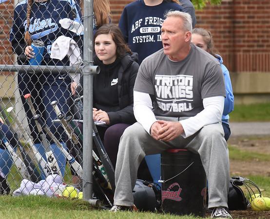BRYAN EATON/Staff Photo. Triton softball head coach Dave Dupere cheers on his team.