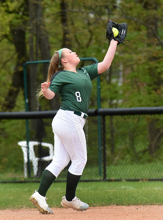 BRYAN EATON/Staff Photo. Pentucket's Emma Lopata catches a pop ball.