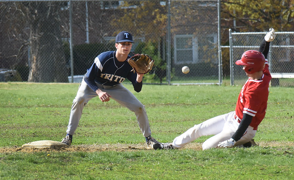BRYAN EATON/Staff photo. Triton second baseman Cameron Gilroy waits for the throw as Tucker Molin is called safe on a steal.