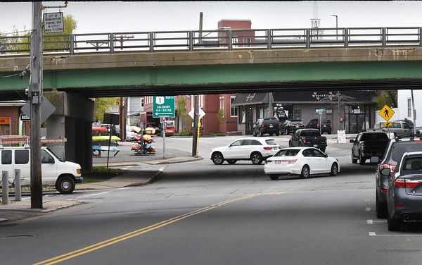 BRYAN EATON/Staff Photo. Vehicles enter and exit the ramps to Route One on Merrimac Street in Newburyport.