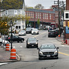 BRYAN EATON/Staff Photo. Newburyport's new parking garage can be seen in back as traffic enters Merrimac Street from Green Street to the left.