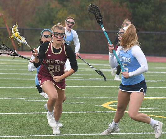 JIM VAIKNORAS/Staff photo Newburyport's Maggie Pons drives on Tritons #5 at Triton Friday.