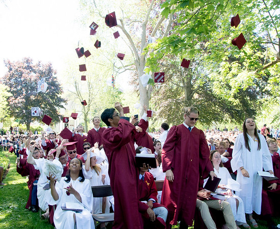 JIM VAIKNORAS/Staff photo 2019 graduates of The Governor's Academy toss their caps after Commencements Sunday morning at the school in Byfield.