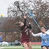 JIM VAIKNORAS/Staff photo Newburyport's Anneliese Truesdale fights for a loose ball with Triton's #2 at Triton Friday.