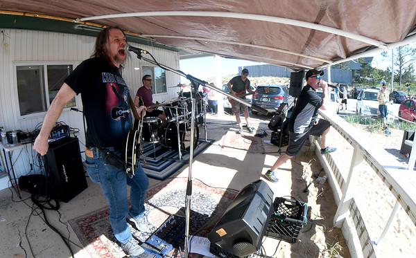 JIM VAIKNORAS/Staff photo The Vinyl Legion Band rock Plum Fest Saturday at Plum Island Center. The band was one of almost 100 to entertain thousands of music lovers throughout the day.