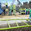 BRYAN EATON/Staff Photo. Timberland employees, volunteering for one of their community service days, Salisbury DPW and town hall employees built a playground at Partridge Brook Park behind Salisbury Elementary School on Thursday along with making improvements and cleaning the nearby dog park and constructing an access trail for students. The $225,000 for the playground, irrigation and concession stand, came from Housing Choice Grant. Eastern Concrete and 5 Elements Landscaping also donated to the cause.