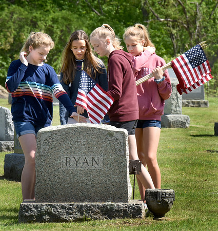 BRYAN EATON/Staff Photo. Nock Middle School seventh-graders placed flags on the graves of veterans at the Belleville and St. Mary's Cemeteries after a Memorial Day assembly at the Newburyport school. From left,  Georgia Cobb, 12, Sophia Franco, Brela Pavao and Addie Varay, all 13.