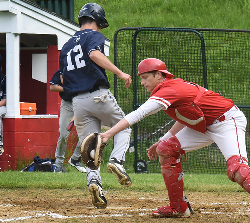 BRYAN EATON/Staff Photo. The throw is late to the Amesbury catcher allowing an Essex Tech player the run.