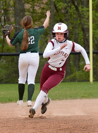 BRYAN EATON/Staff Photo. Newburyport's Anne Siemasko rounds second on a triple.