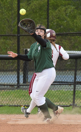 BRYAN EATON/Staff Photo. The throw is late to first baseman Gina D'Agostino allowing Newburyport's Olivia Salvatore the base.