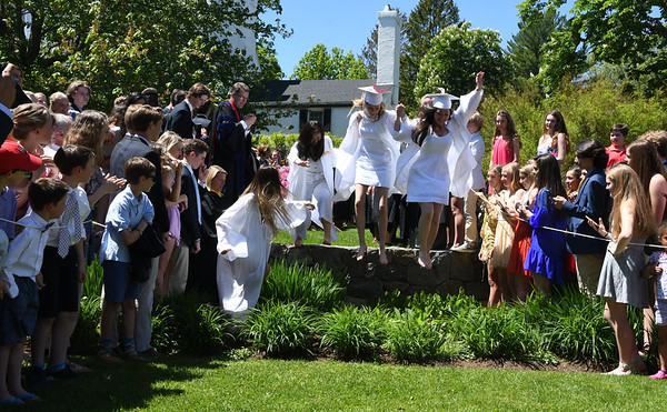 "JIM VAIKNORAS/Staff photo 2019 graduates of The Governor's Academy 'Jump The Wall"" after Commencements Sunday morning at the school in Byfield."