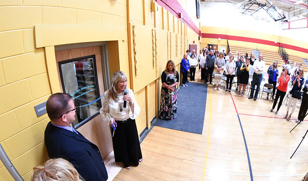 JIM VAIKNORAS/Staff photo Jacalyn Stuart Bennett cuts the ribbon, opening  the Jacalyn Stuart Bennett Mindfulness & Wellness Space at the Nock Middle School Friday.