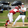 BRYAN EATON/Staff Photo. Pentucket pitcher Jake Etter gets the ball to tag out a Masconomet player who was stuck between third and home.