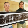BRYAN EATON/Staff Photo. George Mason, left, and son, Michael, with photo of Fourth of July celebration on the Bartlet Mall 100 years ago.